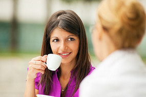 Two women Having a Chat with Coffee